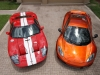 mclaren-mp4-12c-volcano-orange-vs-ford-gt-red-white-001