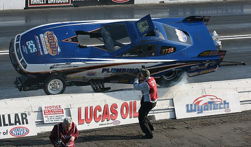 Out of control dragster almost lands on top of photographer ...