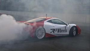 Ferrari 458 Speciale vs Tesla S P85D Donuts