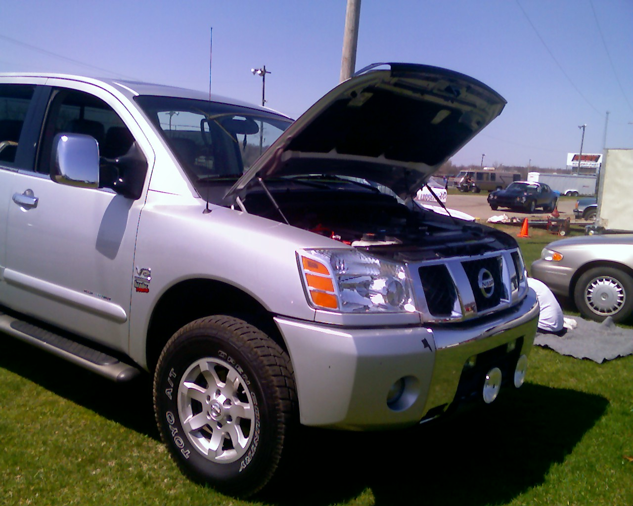 2004  Nissan Titan LE CC 4x4 OR BT picture, mods, upgrades
