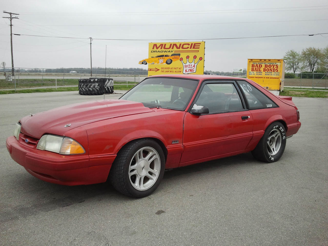 Red 1993 Ford Mustang LX 302