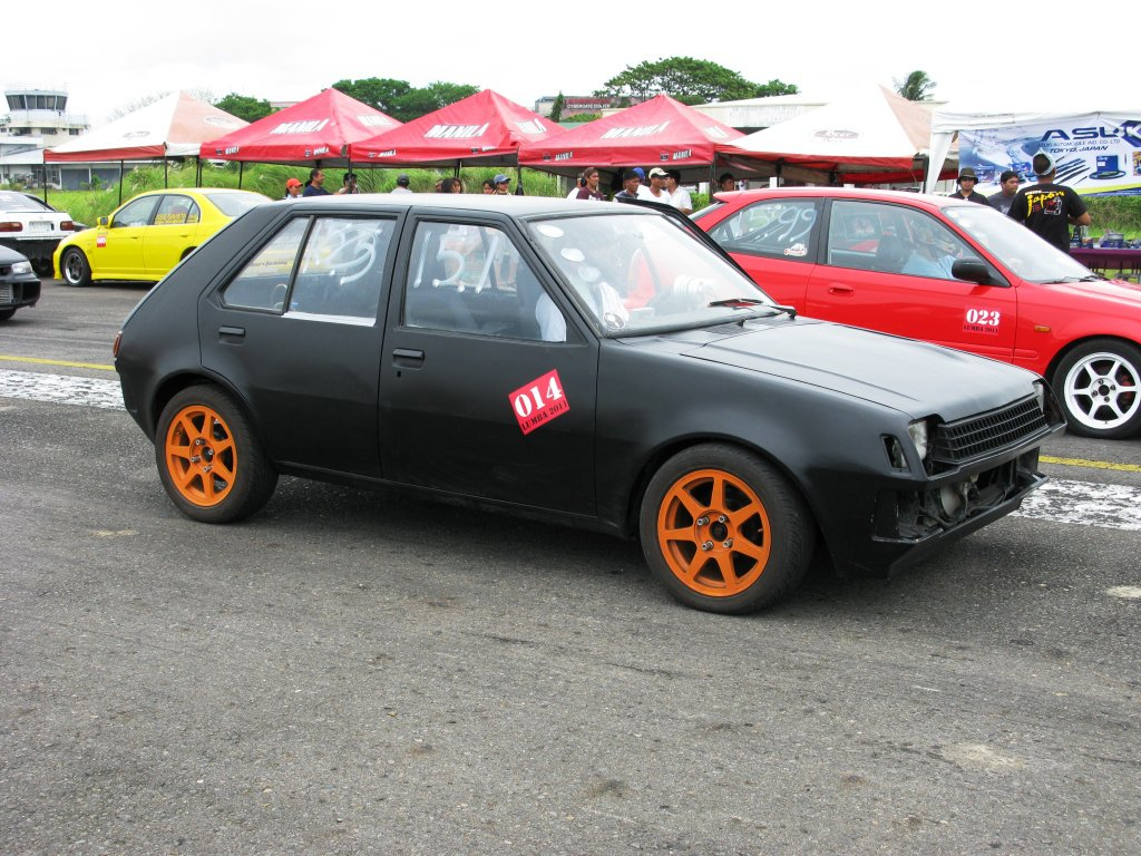 flat black 1982 Mitsubishi Colt sedan