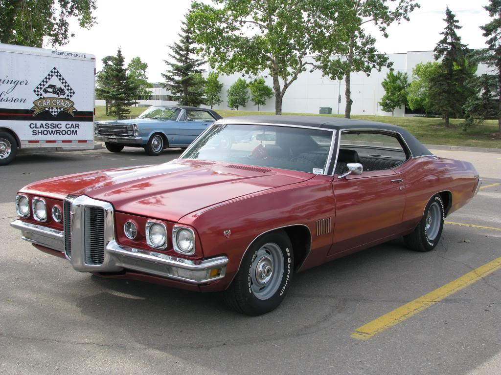 Red, black top 1970 Pontiac 2+2