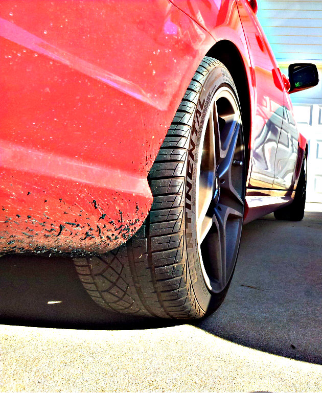 Red 2009 Mercedes-Benz C63 AMG street tire, tune only record.