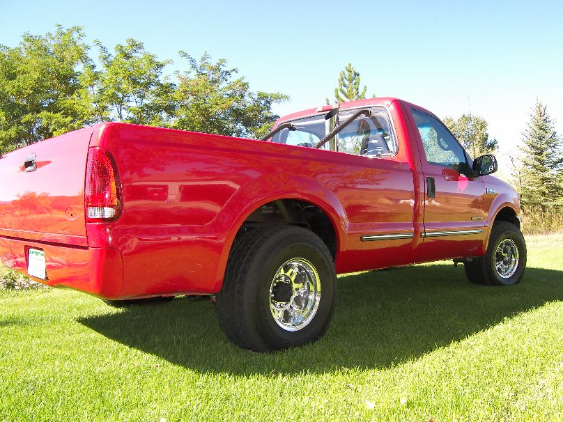 Red 1999 Ford F250 Reg Cab