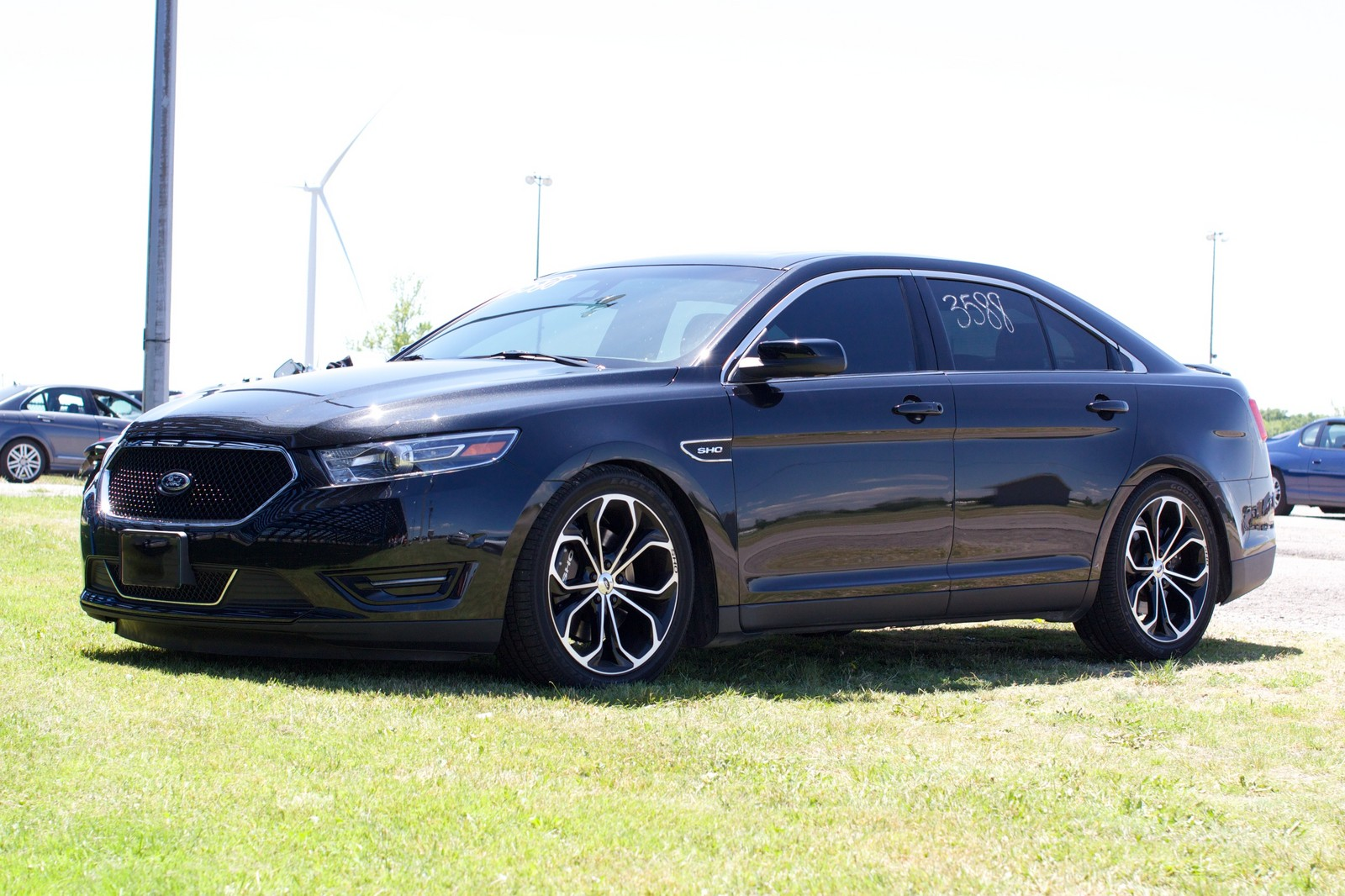 Black 2013 ford taurus sho