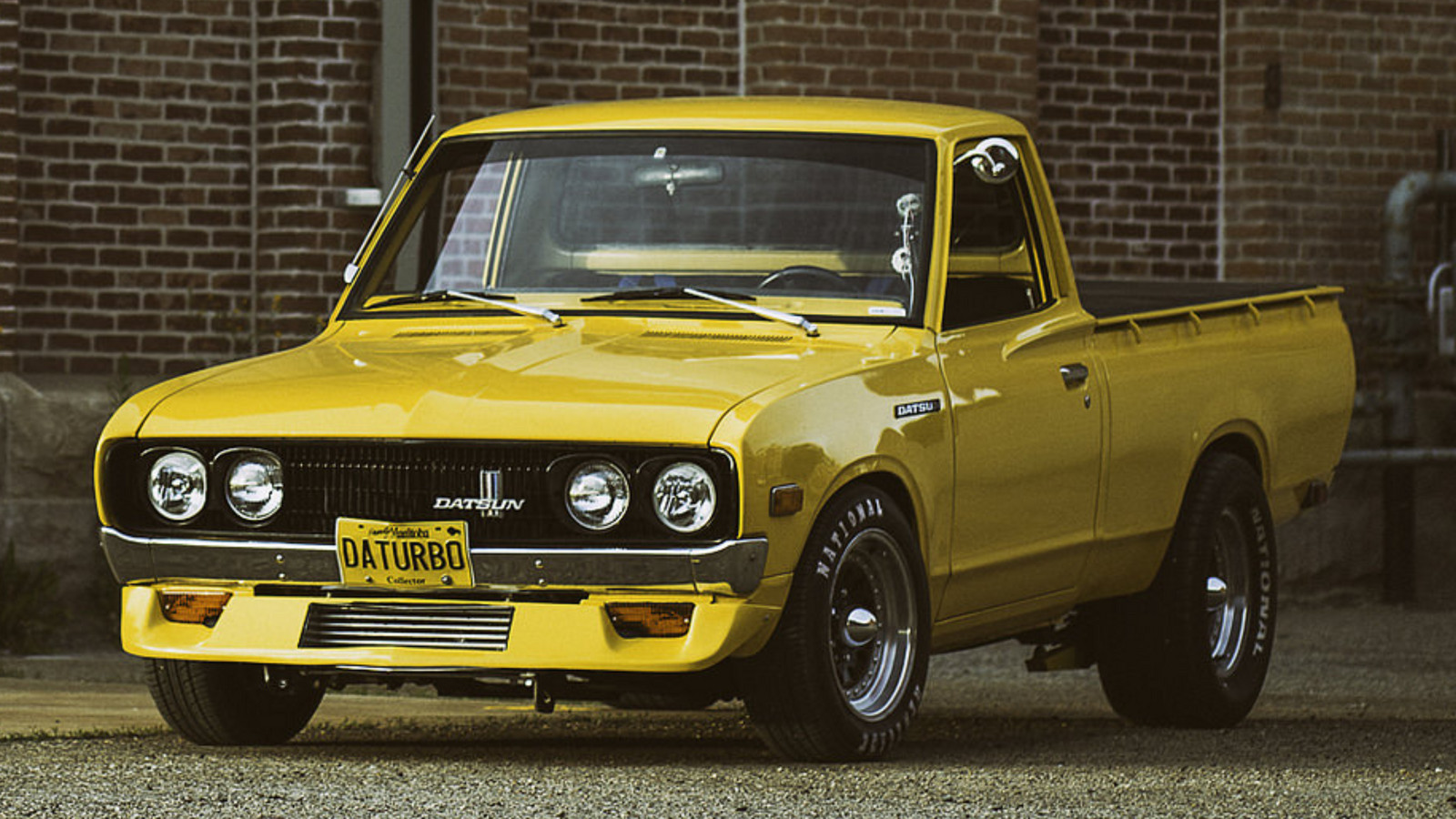 Yellow 1977 Datsun Pickup Sportruck