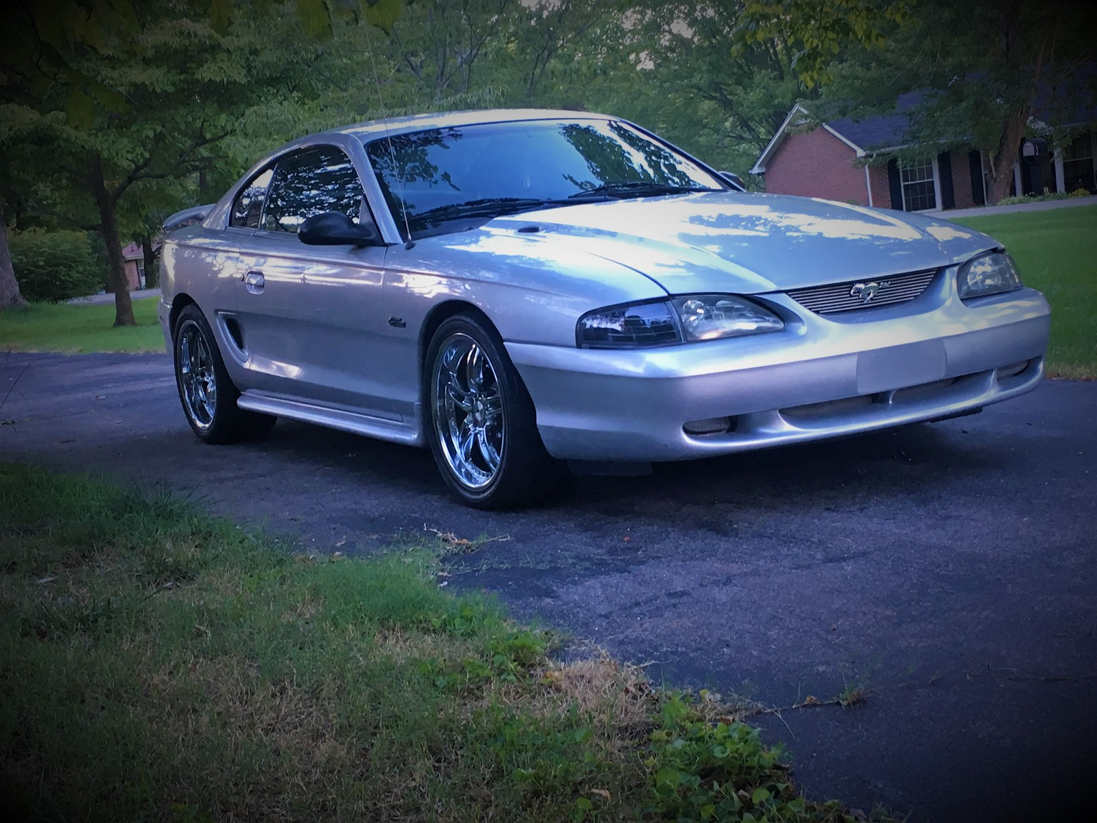 Metalic silver 1998 Ford Mustang GT