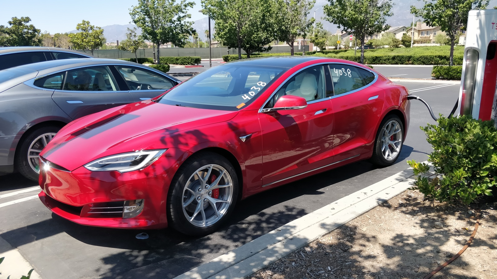 red 2019 Tesla Model S Raven, P100DL
